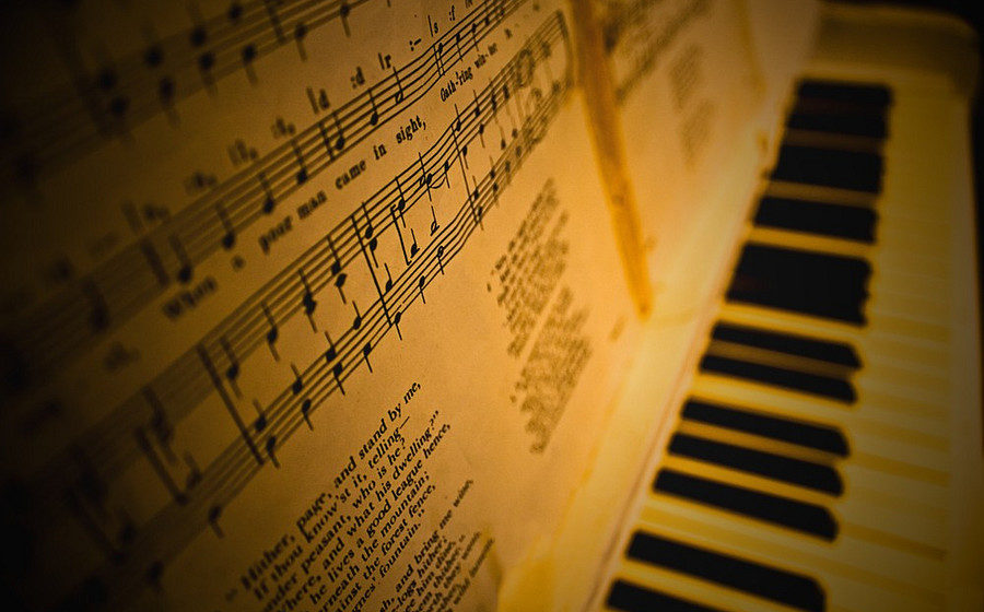 old-white-piano-sheet-music-classical-instruments-colour-photo